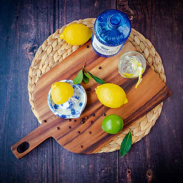Lemons and limes on a chopping board