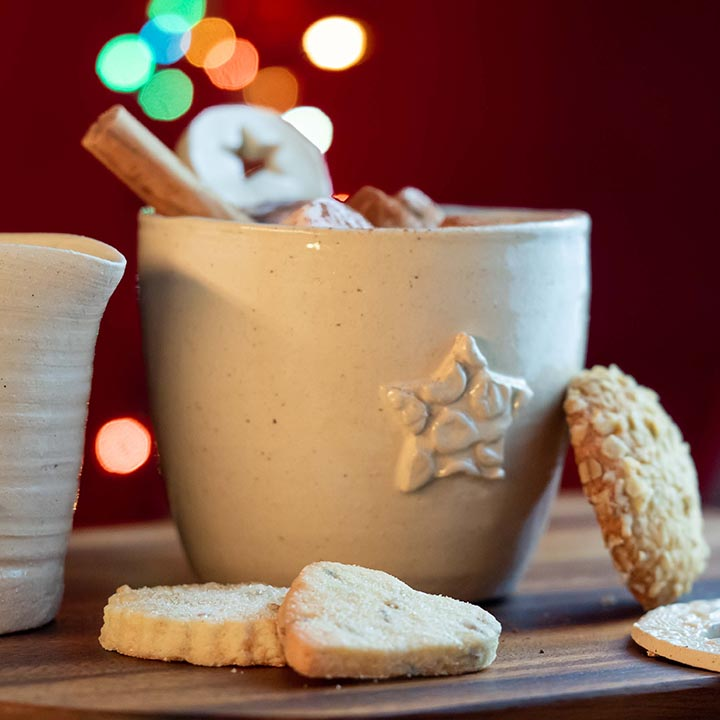 A mug pictured with shortbread biscuits